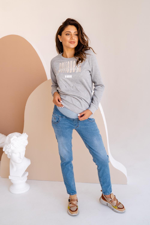 Удобные брюки на перспективу Джинсы для беременных — это универсальный вариант одежды. Тем более, есть модели, которые вы сможете носить после родов. Выбирайте модель с эластичным поясом под животик. Носить такие брюки можно с просторными вещами, которые уже есть в гардеробе, — туникой, рубашкой, футболкой, пайтой.